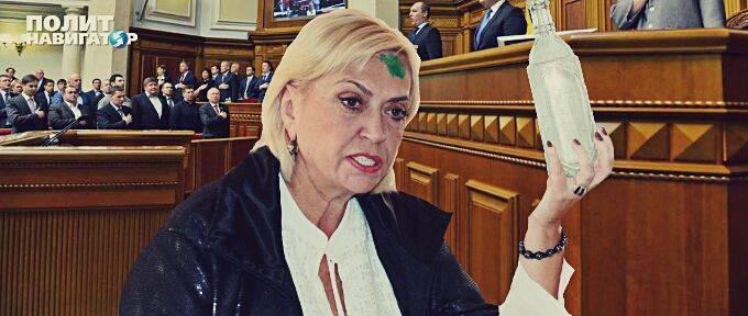 Высокие отношения: Депутат Яценюка разбил бутылкой голову депутатши Тимошенко